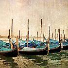 Beautiful gondolas at Venice waterfront. by cloud7