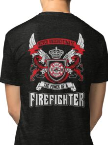 NEVER UNDERESTIMATE THE POWER OF A FIREFIGHTER Tri-blend T-Shirt