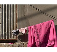 Pink sari and a pink plastic lid Photographic Print