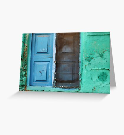 Blue doors in a (very) green wall Greeting Card