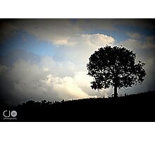 Silhoutte against Stormy Skies Photographic Print