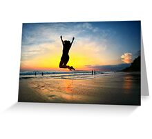 Woman jumping with joy on beach at sunset in Costa Rica Greeting Card