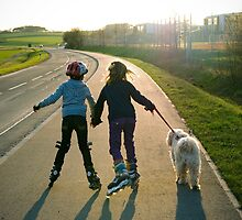 Kids on roller blades. by David A. L. Davies