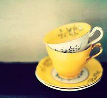 yellow teacups by Catherine  Regan