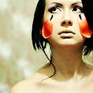 Portrait with tulips  by Tatjana Larina