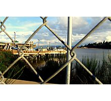 Dock Through Chain Link Photographic Print