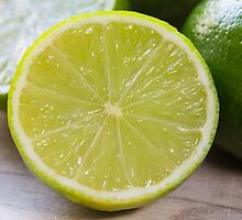 Lime cut as detail on wooden board by wsfbubble