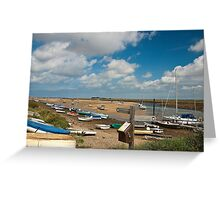 Boats on water and on shore in Wells-next-the-sea Norfolk coast Greeting Card