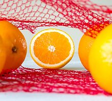 Oranges on a wooden table in the network by wsfbubble