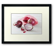 Shallots in the net on white wooden table Framed Print