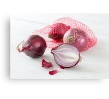 Shallots in the net on white wooden table Metal Print