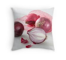 Shallots in the net on white wooden table Throw Pillow