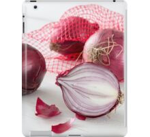 Shallots in the net on white wooden table iPad Case/Skin