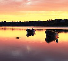 Dawns colors reflecting on Orleans Cove by Roupen  Baker