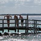25/3 swimmers on an old jetty by Evelyn Bach