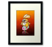 Bunny Sitting on an Easter Egg Framed Print