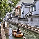 Suzhou canal by Delphimages