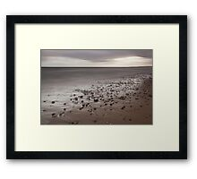pebbles in the sand Framed Print