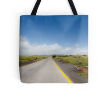 Straight road to vanishing point on the horizon with no traffic. Tote Bag