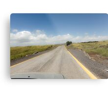Straight road to vanishing point on the horizon with no traffic.  Metal Print