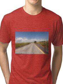 Straight road to vanishing point on the horizon with no traffic.  Tri-blend T-Shirt