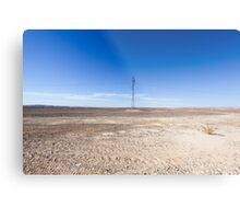 Electricity pylon and power lines in desert Metal Print