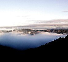 Fog inside volcanic Crater by Chris Chalk