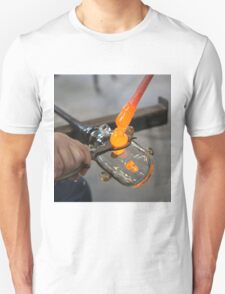 Glassblower cuts molten glass with a hand tool Unisex T-Shirt