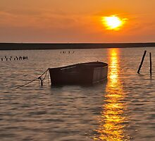 A boat at sunset by Adri  Padmos