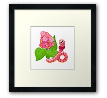 The happy pink worm near the flower Framed Print