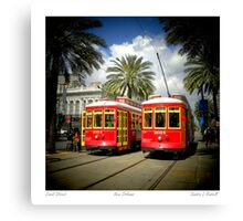 Red Trolly Cars On Canal Street Canvas Print