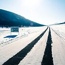 Sun, snow, sky, mountains and bitumen. by UniSoul