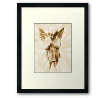 A Little Angel Praying For Children Among All The Nations Framed Print