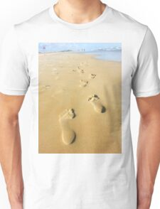 Human footsteps leading away in the sand Unisex T-Shirt