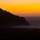Sunset and lighthouse by lightportal