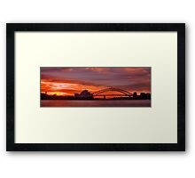 As the sun goes down behind the coat hanger Framed Print