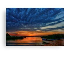 Boat, sunset and dramatic sky Canvas Print