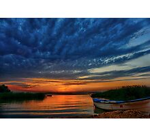 Boat, sunset and dramatic sky Photographic Print