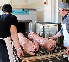 porchetta into the oven by Anne Scantlebury