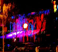 Light playing at night in West Hollywood by Rebecca Dru