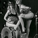 Two sexy ladies wearing masks in music club stage... by Anton Oparin