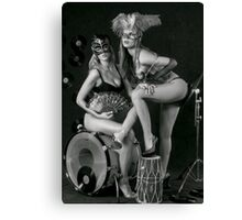Two sexy ladies wearing masks in music club stage... Canvas Print