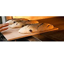 Loaves of bread in a bakery oven. Photographic Print