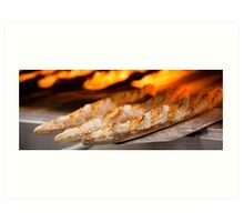 Freshly baked loaves of bread at a bakery. Art Print