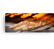 Freshly baked loaves of bread at a bakery. Canvas Print