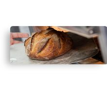 Freshly baked loaf of bread at a bakery. Canvas Print