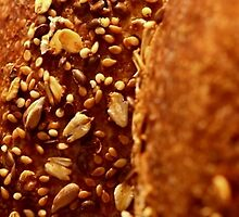 Freshly baked loaves of bread at a bakery.  by PhotoStock-Isra