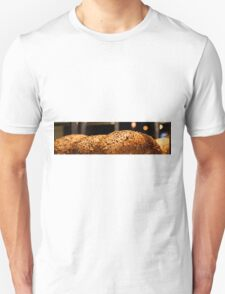 Freshly baked loaves of bread at a bakery.  T-Shirt