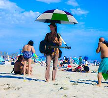 The Man Who Serenades at the Beach by Rebecca Dru