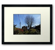 A Thatched Cottage on a Sunny Spring Day Framed Print